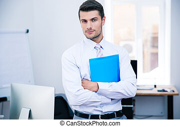 Businessman standing with folder