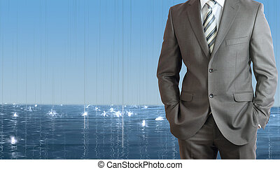 Businessman standing with hands in pockets