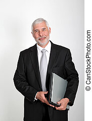 Businessman standing with laptop computer