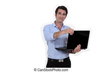 businessman standing with laptop
