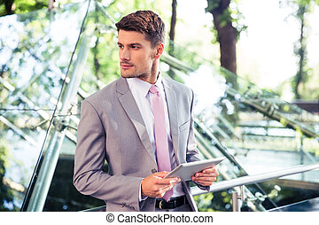 Businessman standing with tablet computer