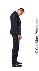 Businessman stands in profile hanging his head , isolated on a white background.