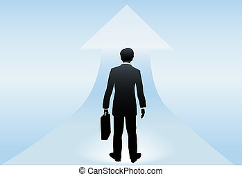 A business man seen from behind stands poised at an up arrow to a bright successful future ahead.