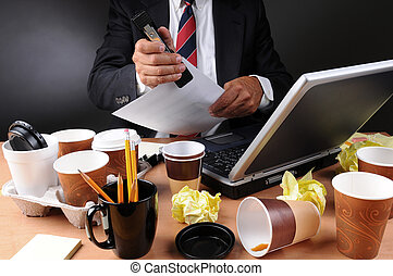 Businessman Stapling Papers at Messy Desk - Closeup view of ...