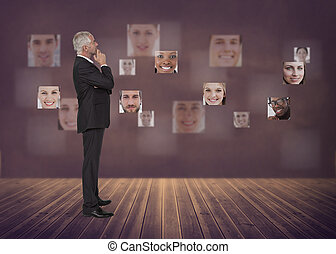 Businessman staring at digital interface