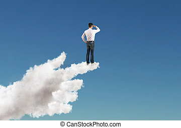 businessman staring into the distance on cloud hand