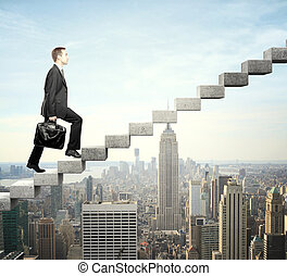stepping up a staircase - Businessman stepping up a ...