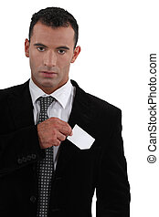 businessman sticking out business card
