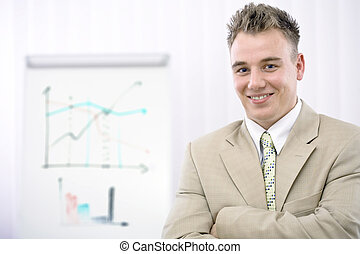 Businessman - Happy young businessman posing in front of...