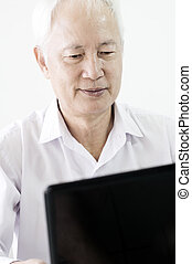 businessman  - old asian business man surfing with a laptop