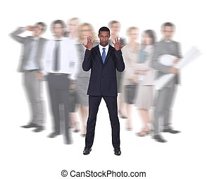 Businessman stood in front of blurred colleagues