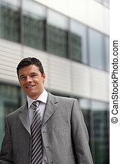 Businessman stood outside office