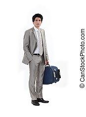 Businessman stood with luggage