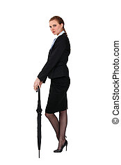 Businessman stood with umbrella