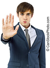 Businessman Stop Gesture - young businessman holding up his...