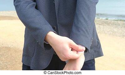 Businessman straightening jacket