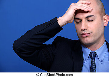 Businessman stressed out at work