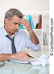 Businessman struggling at his desk