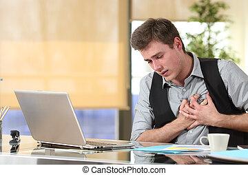 Businessman suffering a heart attack