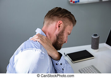 Businessman Suffering From Neck Pain