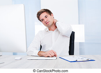 Businessman Suffering From Pain