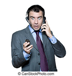 businessman surprised busy with multiple telephone -...