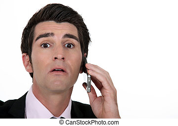 Businessman surprised by call