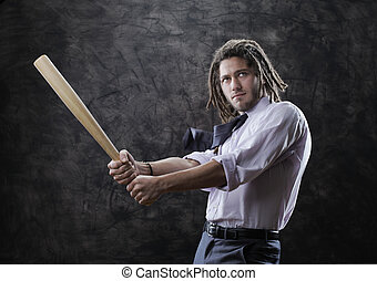Businessman swinging baseball bat