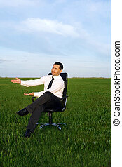 businessman take energy from nature in the meadow