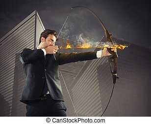 Businessman takes aim - Determinated businessman with...