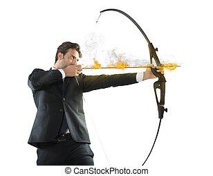Businessman takes aim - Determinated businessman with...