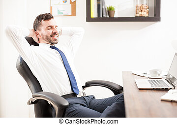 Businessman taking a break from work - Profile view of a...