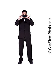 Businessman taking a picture with his phone - Isolated...