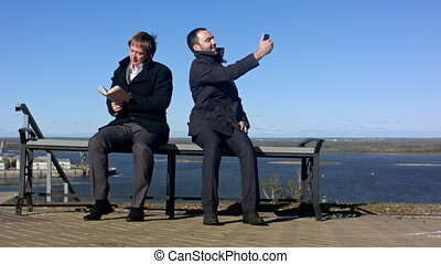 Businessman taking a selfie with a smart phone outdoors