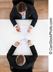 Businessman Taking Interview Of Candidate At Desk