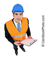 businessman taking notes on a construction site
