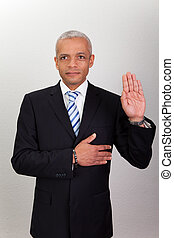 Businessman Taking Oath - Success Man With Arm On Chest...