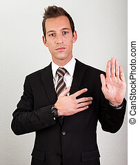 Success Man With Arm On Chest Taking Oath