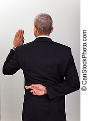 Businessman Taking Oath With Crossed Fingers. Dishonesty concept