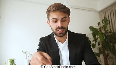 Businessman talking by video call using application for online negotiations