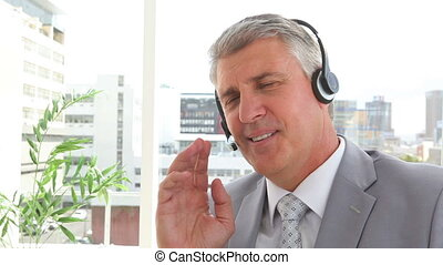 Businessman talking on a headset