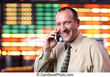 Businessman talking on cell phone - American businessman...