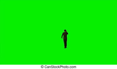 Businessman talking on mobile phone against Green Screen, 4K