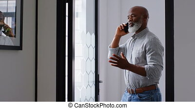 Businessman talking on phone at office 4k