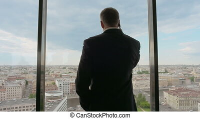 Businessman talking on phone - Mature businessman talking on...
