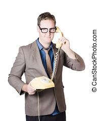 Businessman talking on retro telephone