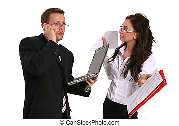businessman talking on the phone and his secretary helping him with documents