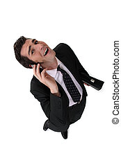 businessman talking on the phone and laughing