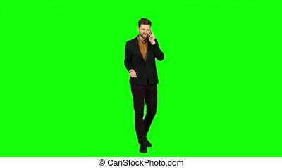 Businessman talking on the phone and nervous, shouts. Green screen