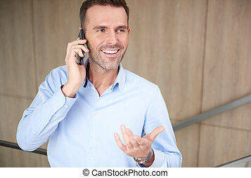 Businessman talking on the phone at work